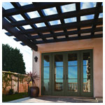 A-Series Frenchwood Hinged Patio Door, Outswing with Specified Equal Divided Light Grilles (1 wide by 3 tall) with Frenchwood Sidelights and Terratone Exterior